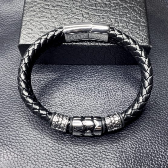 Polished stainless steel and braided Leather Bracelet skillfully handcrafted Magnetic clasp for ease of wear, secure when wearing yet simple to remove